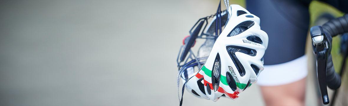 Salice helmet hanging next to bike handlebars