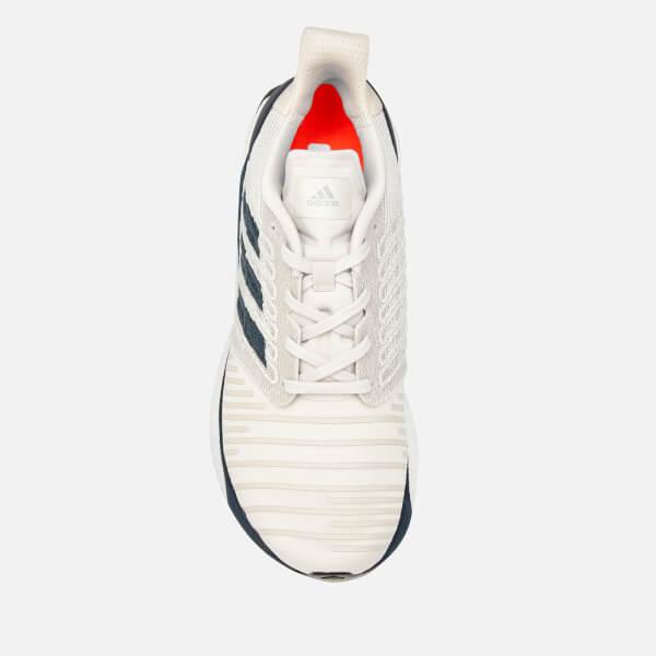 fa4a80bedbf7c adidas Men s Solar Boost Trainers - Raw White Legend Ink True Orange  Image