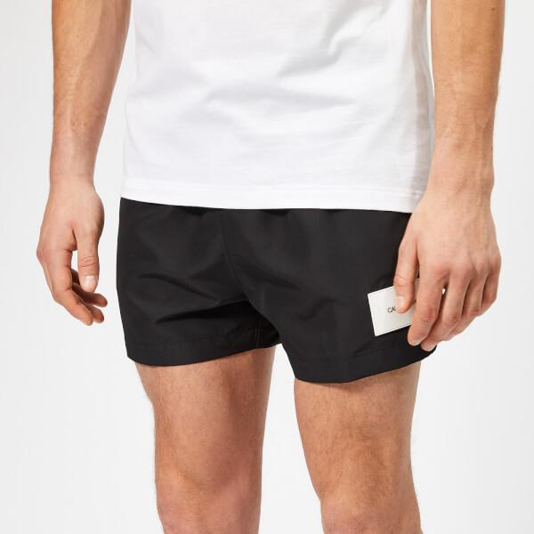 cabfaee04b Calvin Klein Men's Short Swim Shorts - Black: Image 1