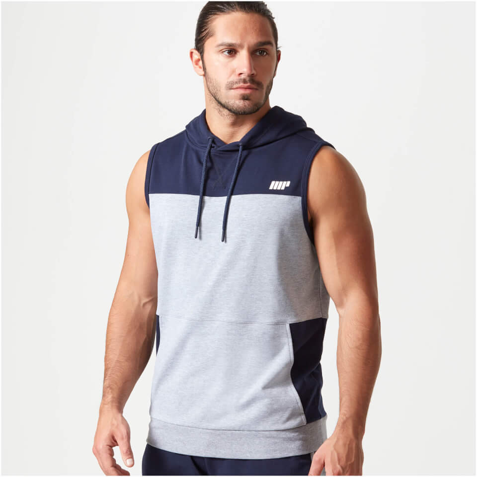 Great warm up sleeveless hoodie for the gym The ut is trim and is definitely made for us muscular guys which is NICE! I like mine in black since it This sleeveless hoodie with side vents looks great on me, is light and can tossed into a gym bag without taking up the much valued real estate of you bag.