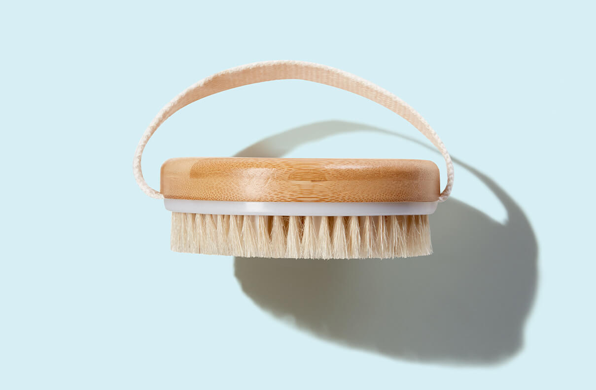 Mio Body Brush displayed in packaging against light blue backdrop. Links to individual product page.