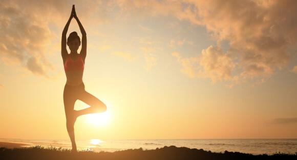 Model in sunshine doing yoga