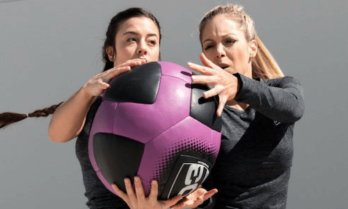 IdealFit women with ball