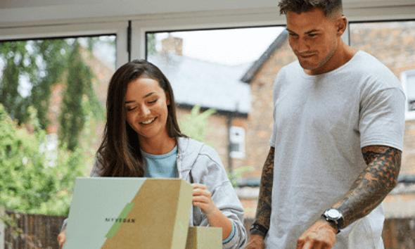 young man and woman open vegan sample box