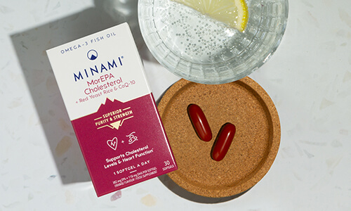 Minami omega-3 MorEPA Cholesterol tablets with glass of water