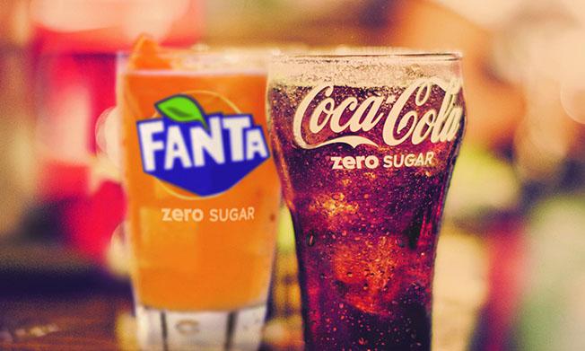 Glasses of cold Fanta Zero Sugar and Coca-Cola Zero Sugar