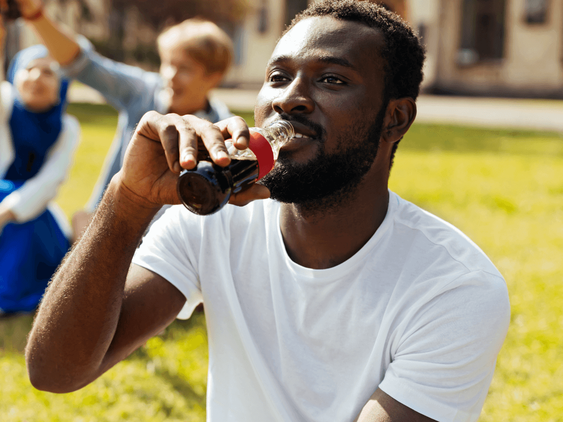 Man enjoying a bottle of Coca Cola