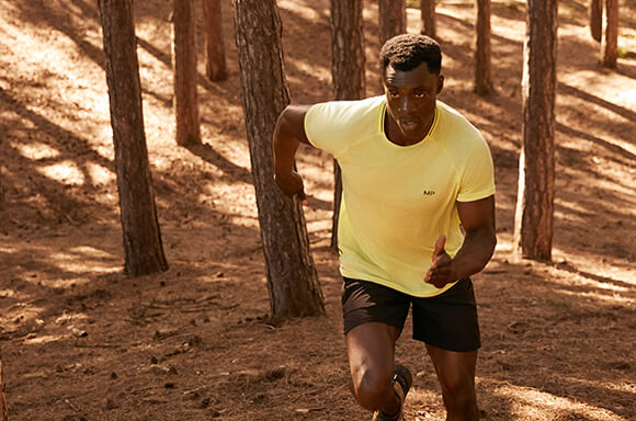 man running in forest